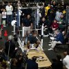 Photo - Scouts, teammates and media gather to watch former Missouri defensive lineman Michael Sam perform the bench press during pro day for NFL football representatives Thursday, March 20, 2014, in Columbia, Mo. (AP Photo/L.G. Patterson)