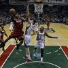 Miami Heat\'s LeBron James (6) shoots during the first half of Game 3 in their first-round NBA basketball playoff series against the Milwaukee Bucks, Thursday, April 25, 2013, in Milwaukee. The Heat won 104-91 to take a 3-0 lead in the series. (AP Photo/Morry Gash)