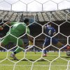 Photo - Greece's Kostas Manolas fails to stop the ball as Colombia's Pablo Armero scores the opening goal during the group C World Cup soccer match between Colombia and Greece at the Mineirao Stadium in Belo Horizonte, Brazil, Saturday, June 14, 2014.  (AP Photo/Frank Augstein)