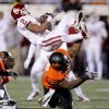 Oklahoma State\'s Tyler Johnson (40) brings down Oklahoma\'s Trey Franks (2)during the Bedlam college football game between the Oklahoma State University Cowboys (OSU) and the University of Oklahoma Sooners (OU) at Boone Pickens Stadium in Stillwater, Okla., Saturday, Dec. 3, 2011. Photo by Bryan Terry, The Oklahoman