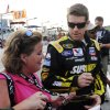 Photo -   Carl Edwards signs autographs before the NASCAR Sprint Cup Series auto race at Atlanta Motor Speedway, Sunday, Sept. 2, 2012, in Hampton, Ga. (AP Photo/David Tulis)