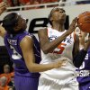 OSU\'s Toni Young (15) tries to get the ball past James Madison\'s Toia Giggetts (3) during the Women\'s NIT championship college basketball game between Oklahoma State University and James Madison at Gallagher-Iba Arena in Stillwater, Okla., Saturday, March 31, 2012. OSU won, 75-68. Photo by Nate Billings, The Oklahoman