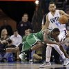Boston Celtics\' Jeff Green, front, falls as he is fouled by Charlotte Bobcats\' Jeffery Taylor, rear, during the first half of an NBA basketball game in Charlotte, N.C., Monday, Feb. 11, 2013. (AP Photo/Chuck Burton)