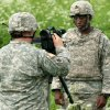 Photo -  Staff Sgt. Christopher Bruce, left, of Harrah, interviews a soldier about his training mission in Tapa, Estonia, on June 10.  Photo by Sgt. Anthony Jones, Oklahoma Army National Guard  <strong>Sgt. Anthony Jones -   </strong>