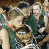 Edmond Santa Fe\'s Taylor Nashert (50) kisses the gold ball championship trophy as Tamara Lee (20), middle, and Jobi Heath (4) look on after the Class 6A girls high school basketball state tournament championship game between Edmond Santa Fe and Edmond Memorial at the Mabee Center in Tulsa, Okla., Saturday, March 10, 2012. Santa Fe won, 44-41. Photo by Nate Billings, The Oklahoman