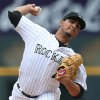 Photo - Colorado Rockies starting pitcher Jhoulys Chacin works against the New York Mets in the first inning of a baseball game in Denver on Sunday, May 4, 2014. (AP Photo/David Zalubowski)