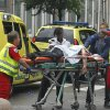 A victim is carried to a waiting ambulance in central Oslo, Friday July 22, 2011, following an explosion that tore open several buildings including the prime minister\'s office, shattering windows and covering the street with documents.(AP Photo/Berit Roald, Scanpix, Norway)