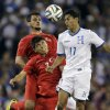 Photo - Turkey's Mustafa Pektemek, background, and Ishak Dogan (3) go up for the ball as Honduras' Andy Najar (17) defends during the first half of an exhibition soccer game, Thursday, May 29, 2014, in Washington. (AP Photo/Luis M. Alvarez)