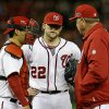 Washington Nationals relief pitcher Drew Storen (22) speaks with catcher Kurt Suzuki, left, and pitching coach Steve McCatty in the ninth inning of Game 5 of the National League division baseball series against the St. Louis Cardinals early Saturday, Oct 13, 2012, in Washington. St. Louis won 9-7. (AP Photo/Alex Brandon)