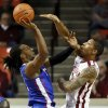 Louisiana Tech\'s Cordarius Johnson (15) shoots against Oklahoma\'s D.J. Bennett (31) during a men\'s college basketball game between the University of Oklahoma Sooners (OU) and the Louisiana Tech Bulldogs at Lloyd Noble Center in Norman, Okla., Monday, Dec. 30, 2013. Photo by Nate Billings, The Oklahoman