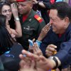 Venezuela\'s President Hugo Chavez greets people as he arrives to a polling station during the presidential election in Caracas, Venezuela, Sunday, Oct. 7, 2012. Chavez is running for re-election against opposition candidate Henrique Capriles. (AP Photo/Rodrigo Abd)