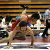 Jemuel Duran from OKC Southeast (top, red) takes down Patrick O\'Brien of Tulsa Edison (right, blue) at the 2012 All State wrestling match that was held at Bixby High School on July 25, 2012. KT KING/Tulsa World