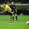 Photo - In this picture taken Sept 14, 2013 Dortmund's Robert Lewandowski , left, scores  a goal during the German Bundesliag soccer match between Borussia Dortmund and Hamburg SV in Dortmund, Germany,. (AP Photo/dpa,, Friso Gentsch)