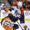 Philadelphia Flyers\' Zac Rinaldo, left, is upended by Florida Panthers\' Dmitry Kulikov, of Russia, during the second period of an NHL hockey game, Thursday, Feb. 7, 2013, in Philadelphia. (AP Photo/Matt Slocum)
