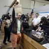 Cale Holdsworth, of Abeline, Kan., holds up his purchase after being the first in line to buy legal recreational marijuana at Top Shelf Cannabis, Tuesday, July 8, 2014, in Bellingham, Wash. Holdsworth had been in line since 4:00 a.m. (AP Photo/Ted S. Warren)