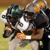 Norman North\'s Z\'Quan Hogan (6) is pushed out of bounds by Norman High\'s Kierstan Pendleton in the second quarter at Gaylord Family-Oklahoma Memorial Stadium in Norman, Okla., on Thursday, Sept. 5, 2013. Photo by Steve Sisney, The Oklahoman