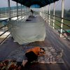 An Indian boy sleeps on a footbridge on a hot morning in New Delhi, India, Wednesday, May 18, 2016. Scorching summer temperatures, hovering well over 40 degrees Celcius, (104 Fahrenheit) are making life extremely tough for millions of poor across north India. Without access to air conditioning and sometimes even an electric fan, they struggle to cope with the heat in their inadequate homes. (AP Photo/Altaf Qadri)