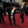 Jason Segel, right, reacts as the red carpet is vacuumed after a substance was dumped by Sacha Baron Cohen before the 84th Academy Awards on Sunday, Feb. 26, 2012, in the Hollywood section of Los Angeles. (AP Photo/Chris Pizzello) ORG XMIT: OSC244