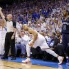 Oklahoma City\'s Derek Fisher looks upmafter making a three pointer as Memphis\' Mike Conely watches during Game 2 in the second round of the NBA playoffs between the Oklahoma City Thunder and the Memphis Grizzlies at Chesapeake Energy Arena In Oklahoma City, Tuesday, May 7, 2013. Photo by Bryan Terry, The Oklahoman