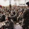 Troops sit in a large room adjacent to the welcome center, listening to information from their drill instructors shortly after arriving at Will Rogers Airport. Nearly 700 soldiers from Ft. Sill, most of whom had recently completed their basic training, arrived at Will Rogers World Airport on buses in pre-dawn hours Thursday, Dec. 20, 2012, to catch flights to join join their families for the Christmas holidays. The troops were welcomed by Blue Star Mothers and other volunteers at the YMCA Military Welcome Center, where they were offered pizzas, doughnuts, chips, sub sandwiches, desserts, hot coffee and cold beverages. Local merchants donated 250 pizzas, 60 dozen doughnuts and the submarine sandwiches. Photo by Jim Beckel, The Oklahoman