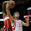 Houston Rockets\' Chandler Parsons (25) goes to the basket in front of Washington Wizards\' Emeka Okafor, left, in the second half of an NBA basketball game, Wednesday, Dec. 12, 2012, in Houston. The Rockets won 99-93. (AP Photo/Pat Sullivan)