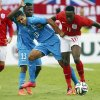 Photo - Honduras' Jorge Claros (20) and Englands' Danny Welbeck (11) battle for the ball during the second half of a friendly soccer match in Miami Gardens, Fla., Saturday, June 7, 2014. The game ended 0-0. ( AP Photo/J Pat Carter)