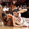 Oklahoma\'s Cameron Clark (21) and Tyler Neal (15) fight Texas\' Julien Lewis (0) for a loose ball during the NCAA men\'s basketball game between the University of Oklahoma and Texas University at the Lloyd Noble Center in Norman, Okla., Tuesday, Feb. 14, 2012. Photo by Sarah Phipps, The Oklahoman
