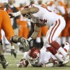 OU\'s Adrian Taylor recovers a fumble under Jeremy Beal in the fourth quarter of the college football game between the University of Oklahoma Sooners (OU) and Oklahoma State University Cowboys (OSU) at Boone Pickens Stadium on Saturday, Nov. 29, 2008, in Stillwater, Okla. STAFF PHOTO BY BRYAN TERRY