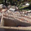 Pieces of a chimney that toppled and went through the roof at the home of Joe and Mary Reneau are pictured from a second-story window in Sparks, Okla., Sunday, Nov. 6, 2011. The chimney was damaged in Saturday night\'s earthquake. (AP Photo/Sue Ogrocki) ORG XMIT: OKSO109