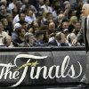 San Antonio Spurs\' Gregg Popovich moves down the sideline during the first half at Game 4 of the NBA Finals basketball series against the Miami Heat, Thursday, June 13, 2013, in San Antonio. (AP Photo/Eric Gay)
