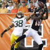 Green Bay Packers defensive back Tramon Williams (38) breaks up a pass intended for Cincinnati Bengals wide receiver A.J. Green (18) during the first half of an NFL football game, Thursday, Aug. 23, 2012, in Cincinnati. (AP Photo/David Kohl)