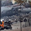 This photo provided by Surete du Quebec, shows debris from a runaway train on Monday, July 8, 2013 in Lac-Megantic, Quebec, Canada. A runaway train derailed igniting tanker cars carrying crude oil early Saturday, July 6. At least thirteen people were confirmed dead and nearly 40 others were still missing in a catastrophe that raised questions about the safety of transporting oil by rail instead of pipeline. (AP Photo/Surete du Quebec, The Canadian Press)