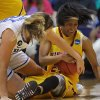Photo - Duke's Tricia Liston fights for a loose ball with Winthrop's Samiya Wright  during the second half of their first-round game in the NCAA basketball tournament in Durham, N.C., Saturday, March 22, 2014. Duke won 87-45.  (AP Photo/Ted Richardson)