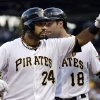 Photo - Pittsburgh Pirates' Pedro Alvarez (24) gestures to the stands after hitting a three-run home run off St. Louis Cardinals starting pitcher Jake Westbrook (35) during the first inning of a baseball game in Pittsburgh, Monday, July 29, 2013. (AP Photo/Gene J. Puskar)
