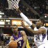 Photo -   Los Angeles Lakers guard Ramon Sessions, left, passes off against Sacramento Kings forward Jason Thompson during the first half of an NBA basketball game in Sacramento, Calif., Thursday, April 26, 2012. (AP Photo/Rich Pedroncelli)