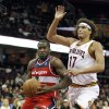 Washington Wizards\' Martell Webster (9) drives past Cleveland Cavaliers\' Anderson Varejao (17) during the first quarter of an NBA preseason basketball game Saturday, Oct. 13, 2012, in Cleveland. (AP Photo/Tony Dejak)