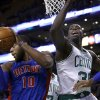 Photo - Detroit Pistons forward Greg Monroe (10) grabs a rebound against Boston Celtics forward Brandon Bass (30) in the first half of an NBA basketball game in Boston, Wednesday, Dec. 18, 2013. (AP Photo/Elise Amendola)