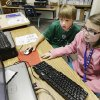 Above: Colton Fuston, 8, a second-grader at Skyview Elementary, and Caitlin Delaney, 9, a fourth-grader at Independence Elementary, work together while learning to write computer code during spring break at Scratch Camp, which was at Skyview Elementary School, in Yukon. Photo by BY PAUL B. SOUTHERLAND, THE OKLAHOMAN