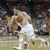 Texas guard Javan Felix (3) drives the ball to the basket against Oklahoma during the second half of an NCAA college basketball game Saturday, Jan. 4, 2014, in Austin, Texas. Oklahoma won 88-85. Felix led all scorers with 28 points. (AP Photo/Michael Thomas)