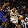 Oklahoma\'s Romero Osby (24) derives around Kansas\' Kevin Young (40) during the second half as the University of Oklahoma Sooners (OU) defeat the Kansas Jayhawks (KU) 72-66 in NCAA, men\'s college basketball at The Lloyd Noble Center on Saturday, Feb. 9, 2013 in Norman, Okla. Photo by Steve Sisney, The Oklahoman