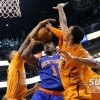 Photo - New York Knicks' Amare Stoudemire (1) has his shot blocked by Phoenix Suns' Markeiff Morris, left, and Channing Frye (8) during the first half of an NBA basketball game, Friday, March 28, 2014, in Phoenix. (AP Photo/Matt York)
