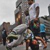 In this June 12, 2014 photo, acrobatic dancer Nasir Malave, 5, works through a routine, in Union Square, New York. Malave, who started dancing when he was 3-years-old by watching music videos, performs with the dance troupe W.A.F.F.L.E. So far this year, the New York Police Department has arrested more than 240 people on misdemeanor charges related to acrobatics on New York City subway trains. This time last year, police had made fewer than 40 such arrests. (AP Photo/Bebeto Matthews)
