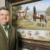 Photo - Darrell Bilke, executive vice president and chief operating officer, in the Pinto Horse Association of America, Inc., offices in Oklahoma City Tuesday, March, 17, 2009. Painting by equine artist Orren Mixer of Edmond who passed away in 2008.  BY PAUL B. SOUTHERLAND, THE OKLAHOMAN ORG XMIT: KOD
