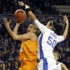 Photo - Kentucky's Azia Bishop (50) pressures the shot of Tennessee's Cierra Burdick during the second half of an NCAA college basketball game at Memorial Coliseum in Lexington, Ky., Sunday, March 3, 2013. Kentucky defeated Tennessee 78-65. (AP Photo/James Crisp)