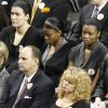 Oklahoma women\'s basketball coach Sherri Coale, right, sits with Oklahoma athletic director Joe Castiglione, left, and members of her team, at rear, during a memorial service in Stillwater, Okla., Monday, Nov. 21, 2011. Oklahoma State women\'s basketball Kurt Budke and assistant women\'s basketball coach Miranda Serna were killed along with pilot Orlin Branstetter and his wife, Paula Branstetter, in a plane crash last Thursday. (AP Photo/Sue Ogrocki) ORG XMIT: OKSO119