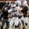 The OSU defense stops Kansas State\'s John Hubert (33) during a college football game between the Oklahoma State University Cowboys (OSU) and the Kansas State University Wildcats (KSU) at Boone Pickens Stadium in Stillwater, Okla., Saturday, Nov. 5, 2011. Photo by Nate Billings, The Oklahoman