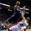 Charlotte Bobcats\' Bismack Biyombo (0) runs into Miami Heat\'s Shane Battier (31) as he drives to the basket during the second half of an NBA basketball game in Charlotte, N.C., Wednesday, Dec. 26, 2012. Biyombo was called for a foul. Miami won 105-92. (AP Photo/Chuck Burton)