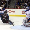 Colorado Avalanche\'s Matt Duchene, front left, tries to get the puck past the defense of Edmonton Oiler Ladislav Smid, back left, and goalie Devan Dubnyk, right, in the third period of an NHL hockey game in Denver, Saturday, Feb. 13, 2013. The Avalanche won 3-1. (AP Photo/The Denver Post, Andy Cross) MAGAZINES OUT; TV OUT; INTERNET OUT; NO SALES