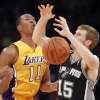 Photo - Los Angeles Lakers guard Wesley Johnson (11) knocks the ball away from San Antonio Spurs forward Matt Bonner (15) in the second quarter of an NBA basketball game Friday, Nov. 1, 2013, in Los Angeles. (AP Photo/Alex Gallardo)