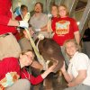 The Elephant Care Team assisting the newborn elephant calf in standing for the first time. It takes many people to help a 304-pound, uncoordinated and tired infant to her feet. Photo credit: Tara Henson Pictured: (front row) Dr. Michelle Davis, Associate Zoo Veterinarian and Dr. Jennifer D